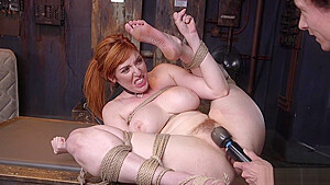 Busty redhead slave fucked...