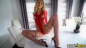Astonishing babe ass is wearing black fishnets while...