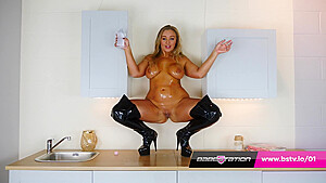 British girl thigh boots covered in baby oil...