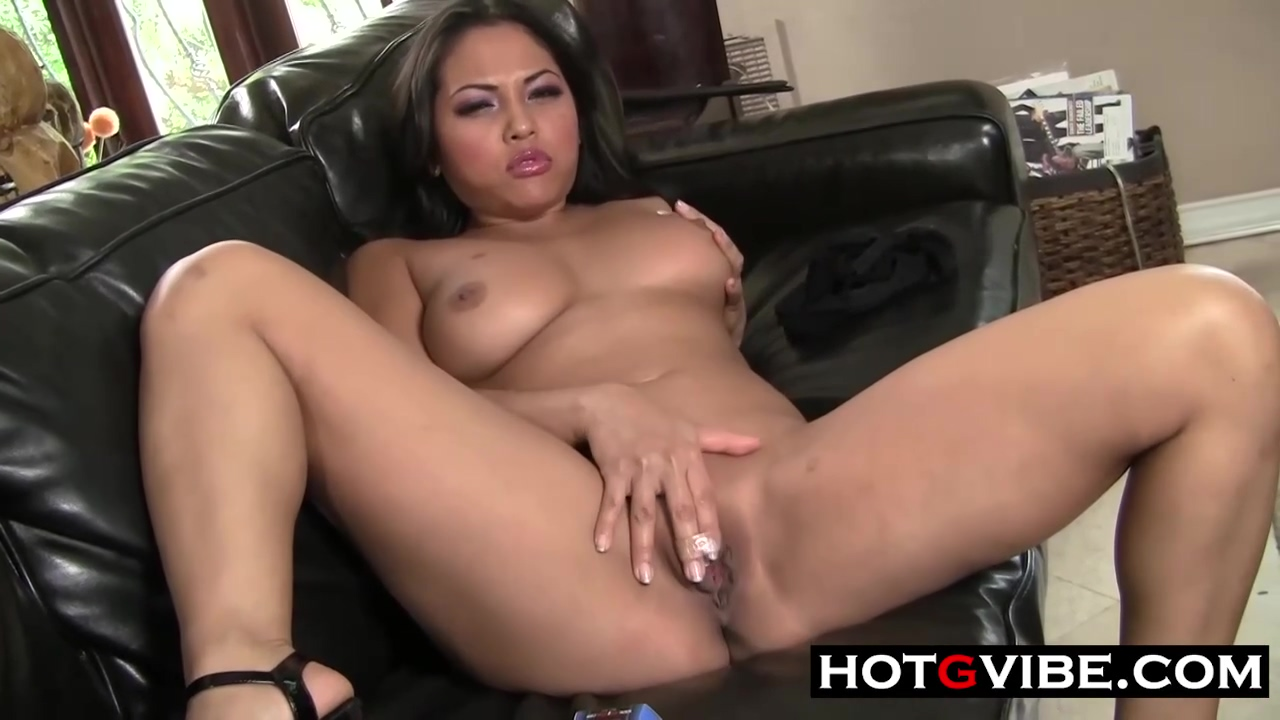 Hot Asian Babe Is Exposing Her Perfectly Shaved Pussy In Front Of The Camera And Loving It
