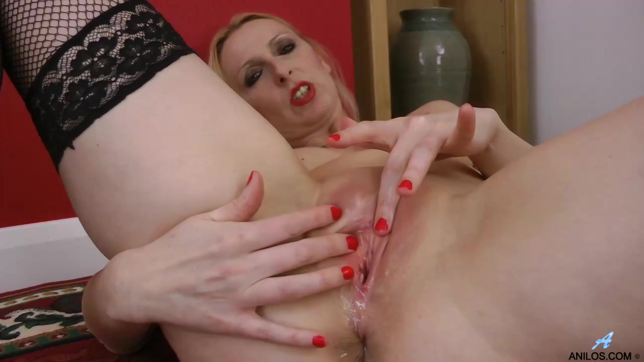 Tracey Hein Is Wearing Black Stockings While Slowly Getting Nude Because She Wants To Masturbate