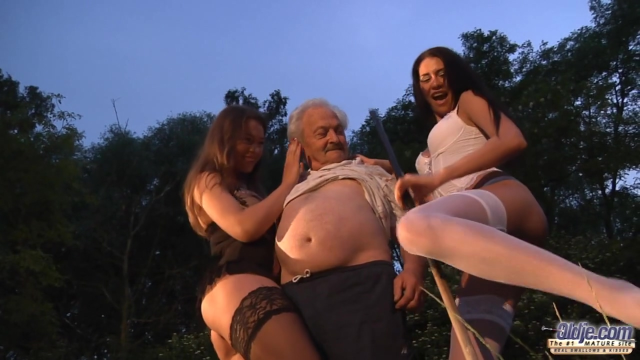 2 Sexy Ladies In Erotic Lingerie Are About To Have A Three-way With An Elderly Guy