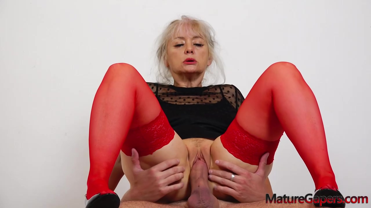 Mature blonde in red pantyhose, Veronique likes to hold her legs spread wide while getting fucked